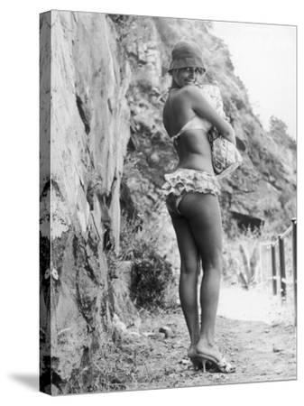 Girl in Bikini Walks Along a Cliff Path on a Fine Summer Day--Stretched Canvas Print