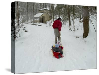 Man Pulling Two Children on a Sled Through the Snow-Todd Gipstein-Stretched Canvas Print