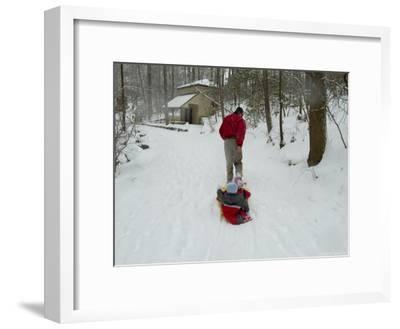 Man Pulling Two Children on a Sled Through the Snow-Todd Gipstein-Framed Photographic Print