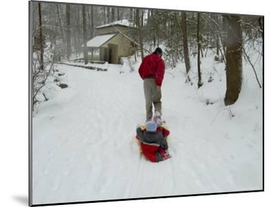 Man Pulling Two Children on a Sled Through the Snow-Todd Gipstein-Mounted Photographic Print