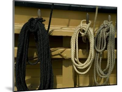Ropes Hanging on Hooks on an Old Wooden Tall Ship-Todd Gipstein-Mounted Photographic Print