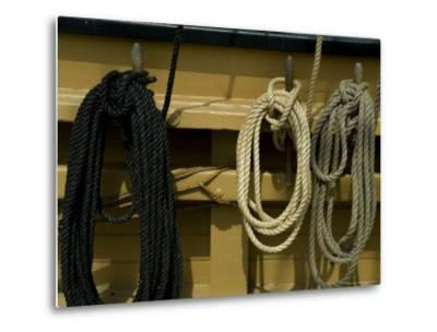 Ropes Hanging on Hooks on an Old Wooden Tall Ship-Todd Gipstein-Metal Print