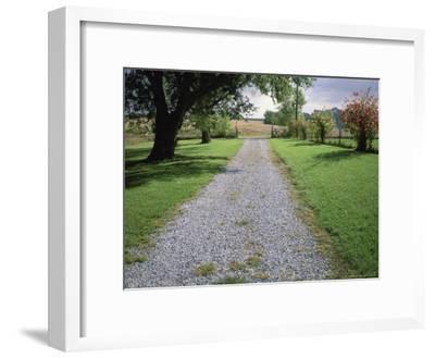 A Gravel Road Marks the Entrance/Exit to Waveland Farm in Nebraska-Joel Sartore-Framed Photographic Print