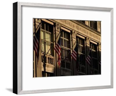 Close View of Flags Hanging on Building in New York-Todd Gipstein-Framed Photographic Print