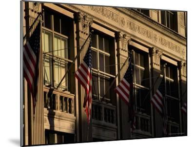 Close View of Flags Hanging on Building in New York-Todd Gipstein-Mounted Photographic Print