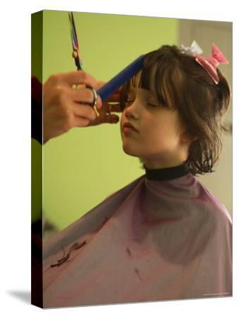 A 6-year-old Girl Gets a Haircut-Stephen Alvarez-Stretched Canvas Print