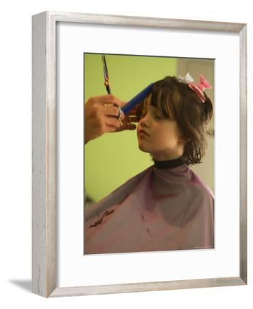 A 6-year-old Girl Gets a Haircut-Stephen Alvarez-Framed Photographic Print
