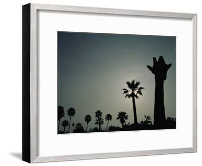 A Silhouette of a Giraffe at the San Diego Wild Animal Park-Michael Nichols-Framed Photographic Print