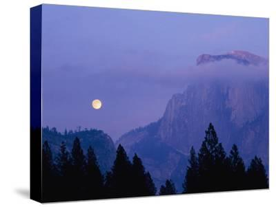 The Moon Rises over Half Dome in Yosemite National Park-Marc Moritsch-Stretched Canvas Print