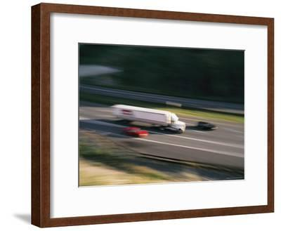 A Truck and Two Cars Barreling Down the Highway-Brian Gordon Green-Framed Photographic Print