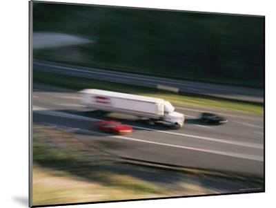 A Truck and Two Cars Barreling Down the Highway-Brian Gordon Green-Mounted Photographic Print
