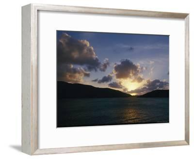 The Sun Hides Behind a Cloud Low in the Sky-Todd Gipstein-Framed Photographic Print