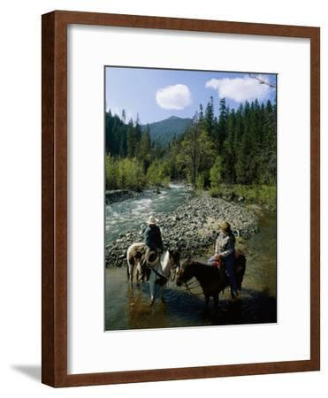Horseback Riders Stand in Coffee Creek-Phil Schermeister-Framed Photographic Print