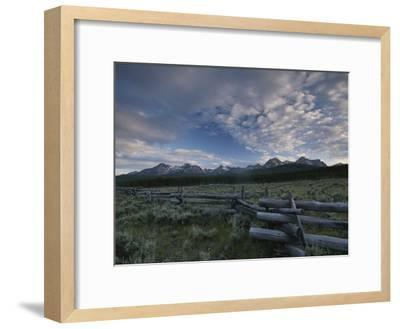 The Sawtooth Mountain Range is a Backdrop for a Split-Rail Fence-Michael Melford-Framed Photographic Print