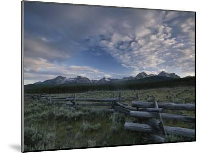 The Sawtooth Mountain Range is a Backdrop for a Split-Rail Fence-Michael Melford-Mounted Photographic Print