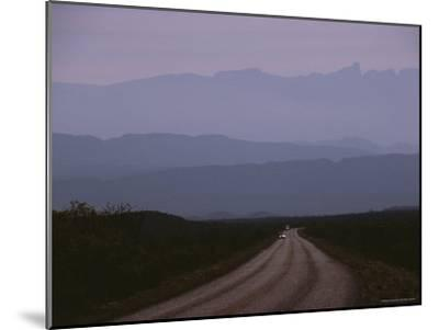 Twilight View of Road Leading to Fog-Shrouded Mountains-Medford Taylor-Mounted Photographic Print