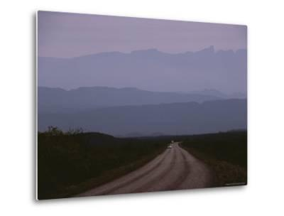 Twilight View of Road Leading to Fog-Shrouded Mountains-Medford Taylor-Metal Print