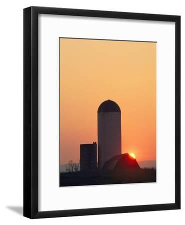 Twilight View of a Barn and Silo Silhouetted against the Sun-Kenneth Garrett-Framed Photographic Print