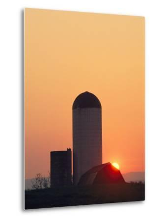 Twilight View of a Barn and Silo Silhouetted against the Sun-Kenneth Garrett-Metal Print