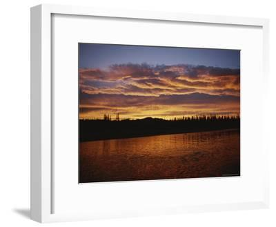 An Intense Sunset Colors Clouds and the Water of the Mackenzie River-Raymond Gehman-Framed Photographic Print