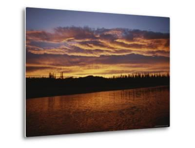 An Intense Sunset Colors Clouds and the Water of the Mackenzie River-Raymond Gehman-Metal Print