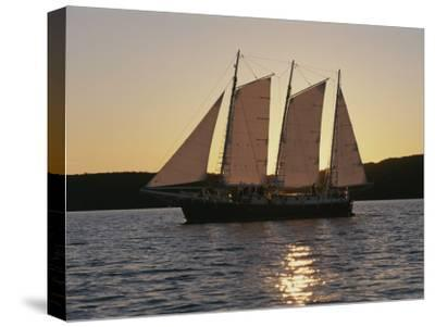 A Ship Cuts Through the Waters of Lake Superior--Stretched Canvas Print