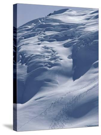 Aerial View of Three Skiers--Stretched Canvas Print