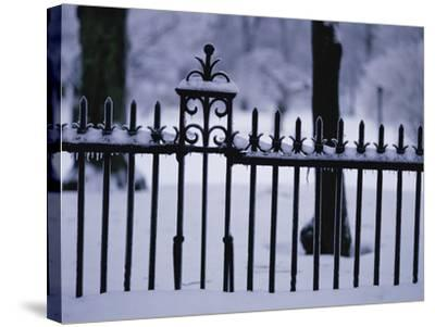 Metal Fence in a Snow Covered Landscape--Stretched Canvas Print