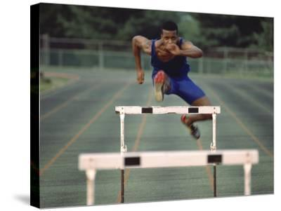 Leaping Over Hurdles--Stretched Canvas Print