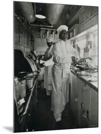 Chef at Work in the Galley of a Baltimore and Ohio Train--Mounted Photographic Print