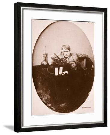 Thomas A. Edison Sitting by His Improved Machine, 1889--Framed Photographic Print