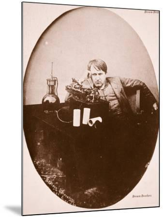 Thomas A. Edison Sitting by His Improved Machine, 1889--Mounted Photographic Print