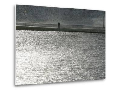 A Man Stands on the Banks of a Small Lake, Munich, on Friday, November 3, 2006.-Christof Stache-Metal Print