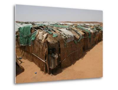 Two Sudanese Boys Stand by Makeshift Huts--Metal Print
