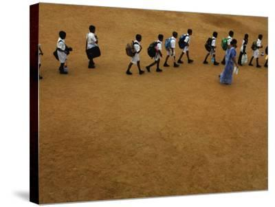 Children Follow Their Teacher as They Head Back to School for the First Time after the Tsunami--Stretched Canvas Print