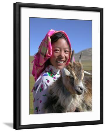 Tibetan Girl Holding Sheep in the Meadow, East Himalayas, Tibet, China-Keren Su-Framed Photographic Print