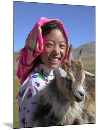 Tibetan Girl Holding Sheep in the Meadow, East Himalayas, Tibet, China-Keren Su-Mounted Photographic Print
