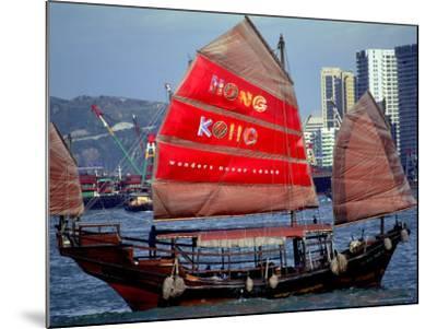Duk Ling Junk Boat Sails in Victoria Harbor, Hong Kong, China-Russell Gordon-Mounted Photographic Print