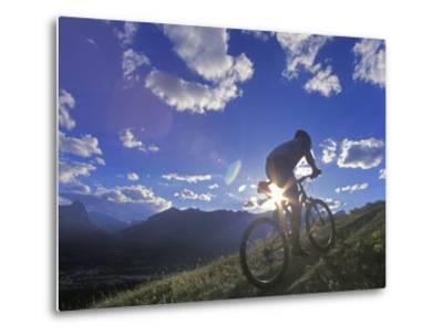 Mountain Biker at Sunset, Canmore, Alberta, Canada-Chuck Haney-Metal Print