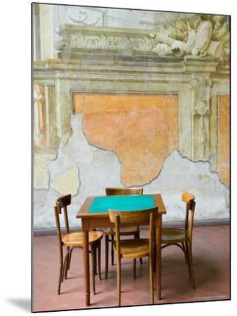 Table and Wall at 15th century Sedile Dominova Social Club, Sorrento, Campania, Italy-Walter Bibikow-Mounted Photographic Print