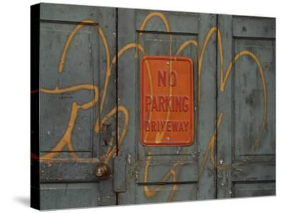 Gray Wooden Doors with Yellow Grafiti Lettering and an Orange Sign--Stretched Canvas Print