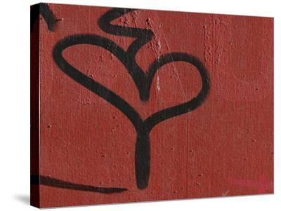 Close-up of a Red Wall and a Black Grafiti Heart Shape--Stretched Canvas Print