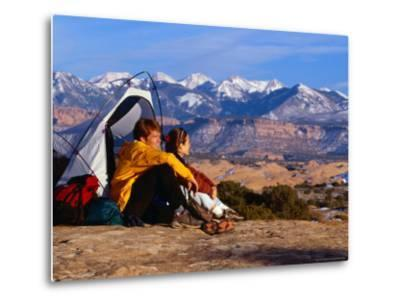 Couple Camping at Slickrock with Snow-Capped Peaks in the Background, Utah, USA-Cheyenne Rouse-Metal Print