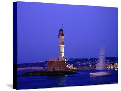 Yacht Sailing Past Hania Lighthouse at Dusk, Hania, Greece-Glenn Beanland-Stretched Canvas Print
