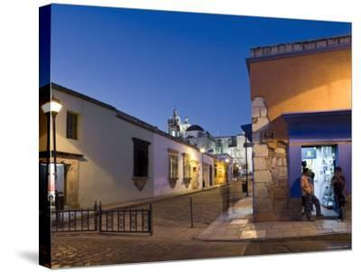 People Stood in Shop Doorway at Dusk, Oaxaca, Oaxaca State, Mexico-Peter Adams-Stretched Canvas Print