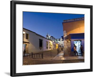 People Stood in Shop Doorway at Dusk, Oaxaca, Oaxaca State, Mexico-Peter Adams-Framed Photographic Print