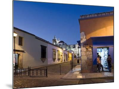People Stood in Shop Doorway at Dusk, Oaxaca, Oaxaca State, Mexico-Peter Adams-Mounted Photographic Print