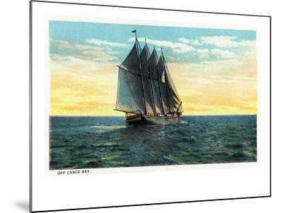 Casco Bay, Maine - View of a Sailboat off the Bay-Lantern Press-Mounted Art Print