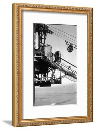 Golden Gate Bridge Spinning Wheel at Tower Top View - San Francisco, CA-Lantern Press-Framed Art Print