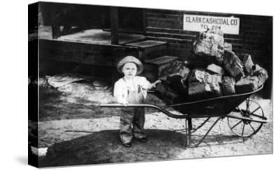 Little Boy Pushing Wheelbarrow of Coal - Elkhart, IN-Lantern Press-Stretched Canvas Print